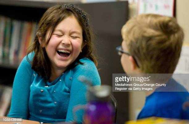 Ruby Chriss shares a laugh with Spencer Fox at right during fourthgrade math at Stonegate Elementary School in Irvine The children were putting...