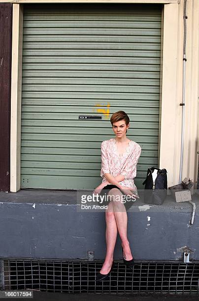 Ruby Jean wears shorts and bag by Marc Jacobs and a vintage top during MercedesBenz Fashion Week Australia Spring/Summer 2013/14 at Carriageworks on...
