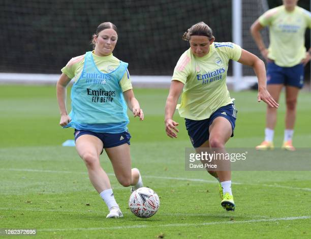 Ruby Mace challenges Melisa Filis of Arsenal during the Arsenal Women training session at Arsenal Academy on July 29 2020 in Walthamstow England