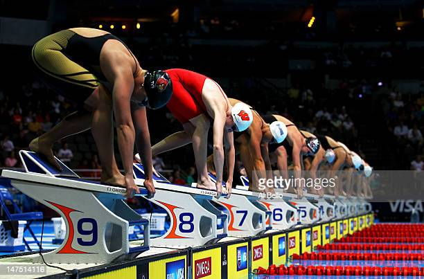 Ruby Martin gets set for the start on the block along with the rest of the field as they prepare to compete in preliminary heat 9 of the Women's 50 m...