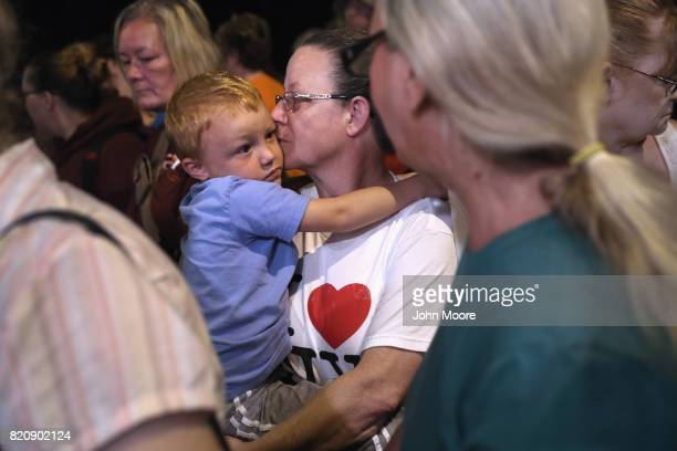 Ruby Partin and her adoptive son Timothy Huff wait for a free clinic to open in the early morning of July 22 2017 in Wise Virginia Hundreds of...