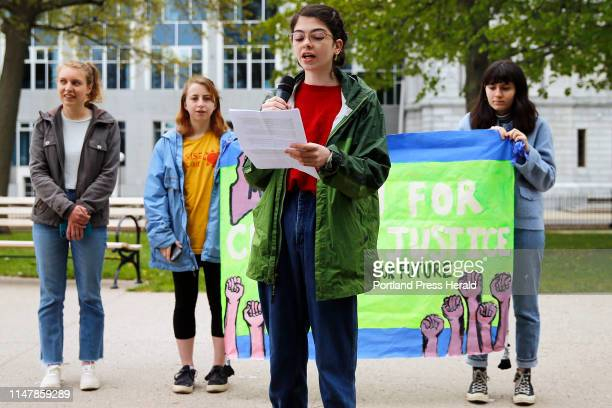 Ruby Peterman a student at Baxter Academy for Technology and Science, speaks in Lincoln Park on Saturday as part of a series of coordinated national...