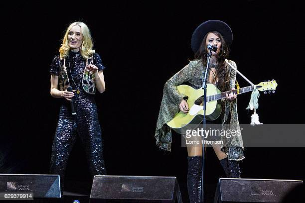 Ruby Stewart and Alyssa Bonagura of The Sisterhood perform at The O2 Arena on December 12 2016 in London England