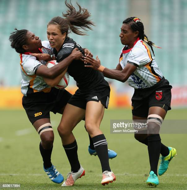 Ruby Tui of New Zealand is tackled during the pool match between New Zealand and Papua New Guinea in the 2017 HSBC Sydney Sevens at Allianz Stadium...