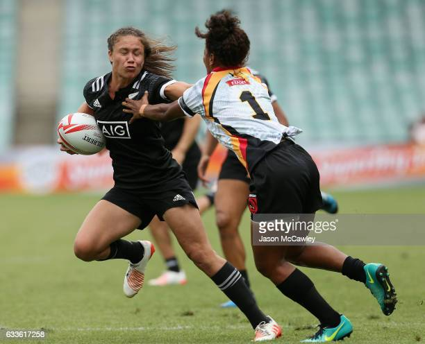 Ruby Tui of New Zealand puts a fend on Kymlie Rapilla of Papua New Guinea during the pool match between New Zealand and Papua New Guinea in the 2017...