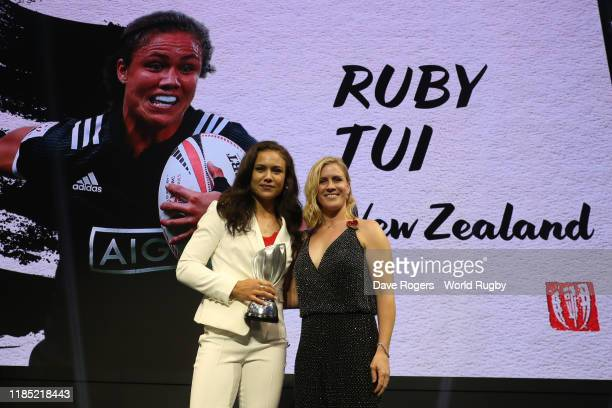 Ruby Tui of New Zealand winner of the World Rugby Women's Sevens Player of the Year in association with HSBC is presented with her award by Danielle...