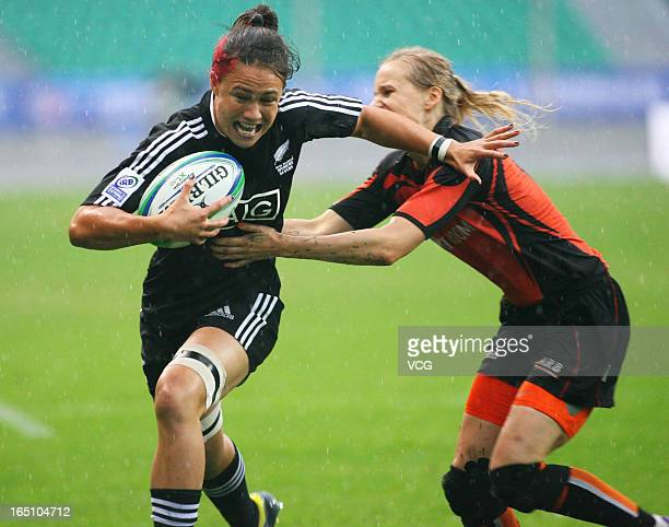 Ruby Tui of New Zealand Women's Sevens team makes a break in the match against Netherlands during the third round of the IRB Women's Sevens World...