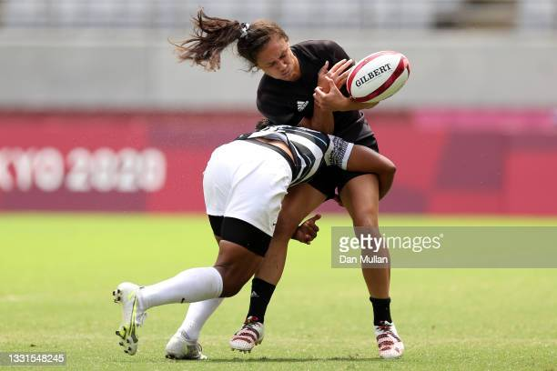 Ruby Tui of Team New Zealand loses the ball in a tackle by Rusila Nagasau of Team Fiji in the Women's Semi Final match between Team New Zealand and...