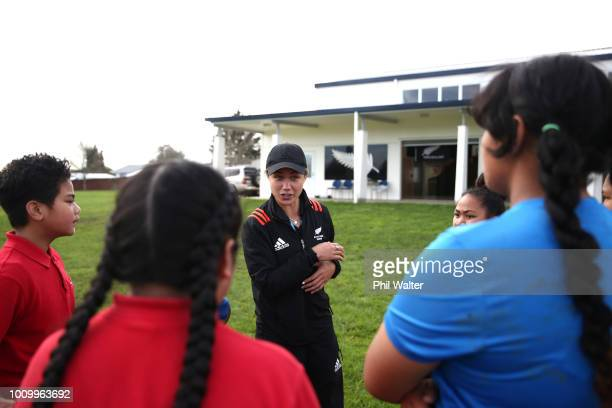 Ruby Tui of the Black Ferns leads school children in some basic rugby skills and fitness training during the the New Zealand Black Ferns Sevens World...