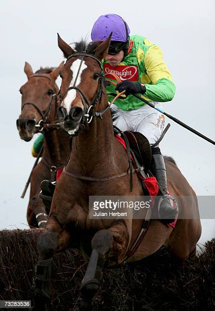 Ruby Walsh and Kauto Star clear the second last fence before landing The AON Steeple Chase Race run at Newbury Racecourse on February 10 2007 in...