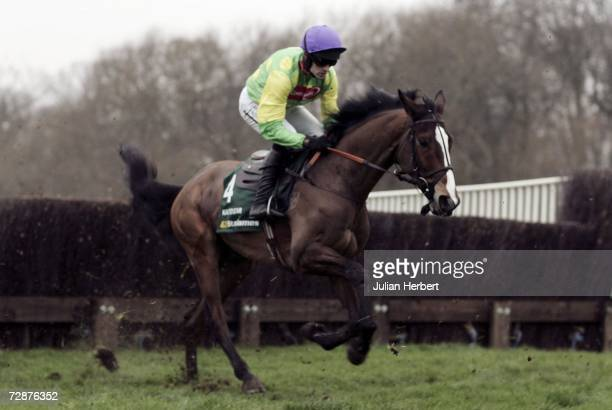 Ruby Walsh and Kauto Star pull away from the first fence before landing The King George VI Steeple Chase Race at Kempton Racecourse on December 26,...