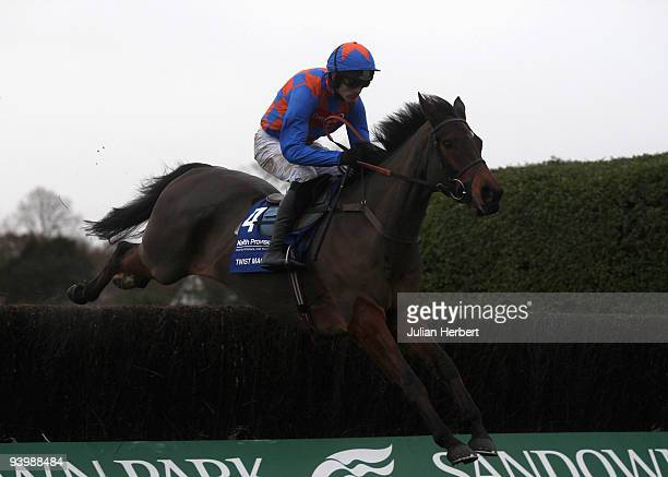 Ruby Walsh and Twist Magic clear the 2nd fence before going on to win TheKeith Prowse Hospitality Tinglre Creek Steeple Chase Race run at Sandown...