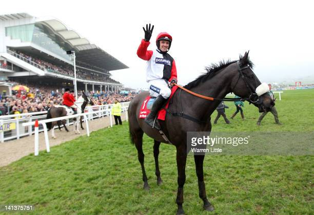 Ruby Walsh celebrates after ridding Big Bucks to victory in the Ladbrokes World Hurdle Race at Cheltenham Racecourse on March 15, 2012 in Cheltenham,...