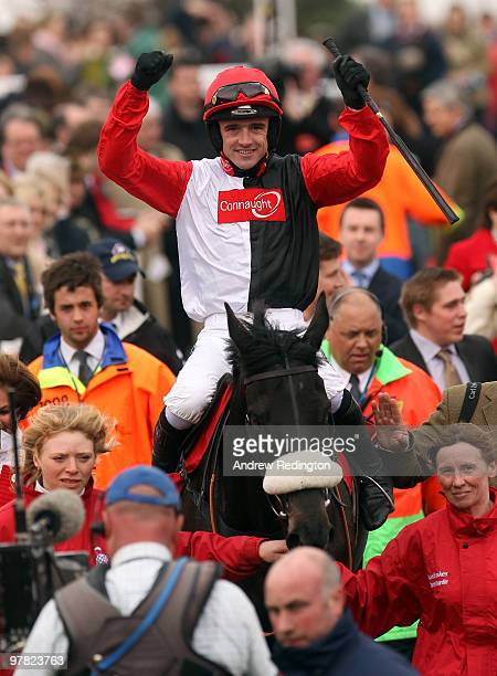 Ruby Walsh celebrates after riding Big Buck's to victory in the Ladbrokes World Hurdle on Day Three of the Cheltenham Festival on March 18, 2010 in...