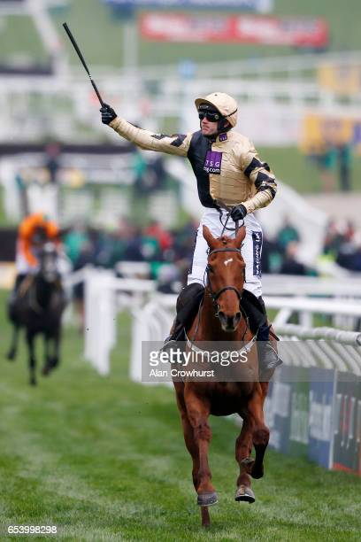Ruby Walsh celebrates after riding Yorkhill to win The JLT Novices' Steeple Chase during St Patrick's Thursday on day three of the festival meeting...
