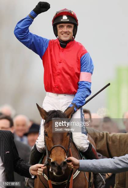 Ruby Walsh celebrates after winning the David Nicholson Mares' Hurdle Race on Quevega at Cheltenham Racecourse on March 15 2011 in Cheltenham England