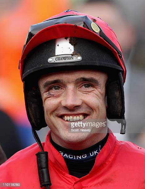 Ruby Walsh celebrates after winning the David Nicholson Mares' Hurdle Race on Quevega at Cheltenham Racecourse on March 15, 2011 in Cheltenham,...