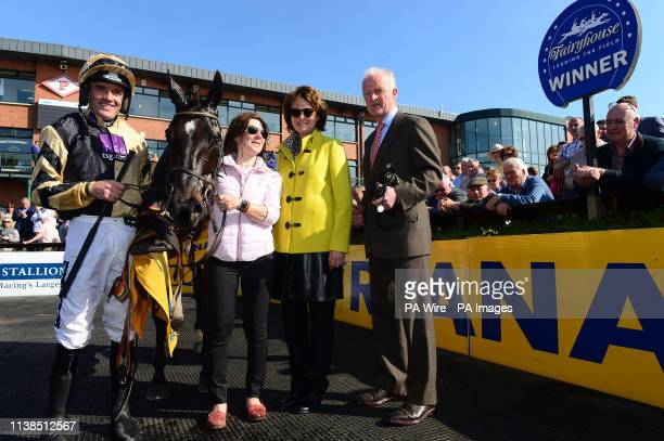 Ruby Walsh celebrates alongside Willie Mullins with wife Jackie and groom Virginia Beaucop alongside Voix Du Reve after winning the Ryanair Gold Cup...