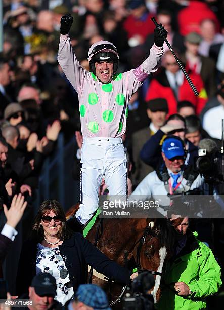 Ruby Walsh celebrates on board Faugheen after winning The Stan James Champion Hurdle Challenge Trophy during Day One of the Cheltenham Festival at...