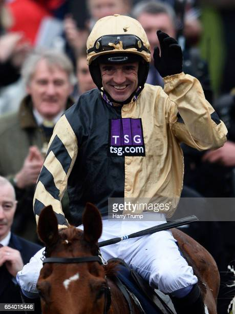 Ruby Walsh celebrates on board Yorkhill after victory in the JLT Novices Steeple Chase during St Patrick's Thursday of the Cheltenham Festival at...