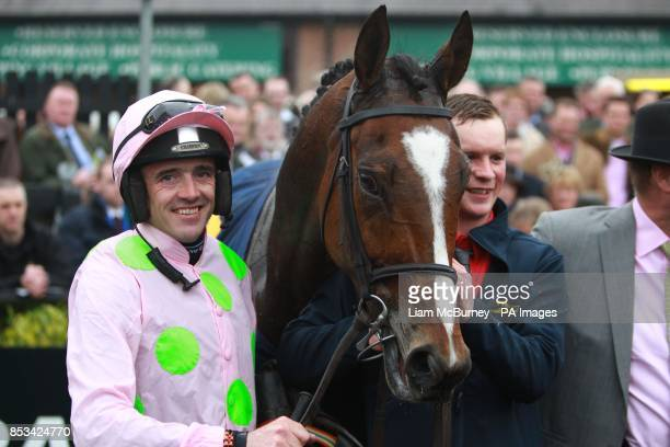 Ruby Walsh celebrates winning The Tattersalls Ireland Champion Novice Hurdle on Vautour during day four of the Punchestown Festival at Punchestown...