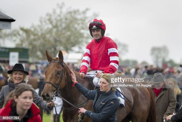 Ruby Walsh celebrates winning the The AES Champion Four Year Old Hurdle on Abbyssial during day five of the Punchestown Festival at Punchestown...
