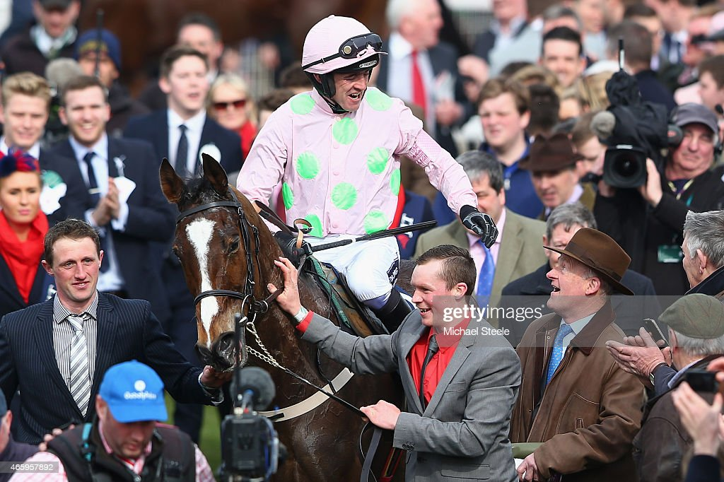 Ruby Walsh celebrates with trainer Willie Mullins (R) after victory on Vautour iin the JLT Novices' Steeplechase during day three of the Cheltenham Festival at Cheltenham Racecourse on March 12, 2015 in Cheltenham, England.