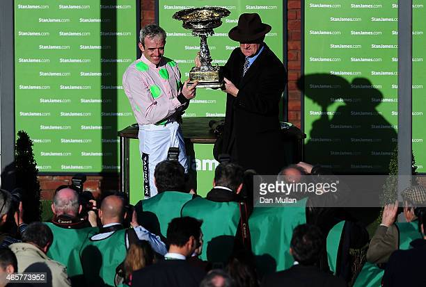 Ruby Walsh celebrates with Willie Mullins after winning The Stan James Champion Hurdle Challenge Trophy during Day One of the Cheltenham Festival at...