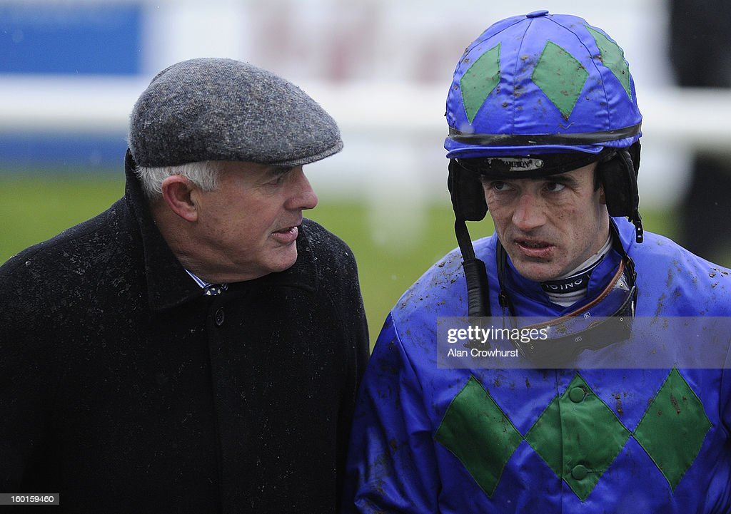 Ruby Walsh chats with his father Ted at Leopardstown racecourse on January 27, 2013 in Dublin, Ireland.