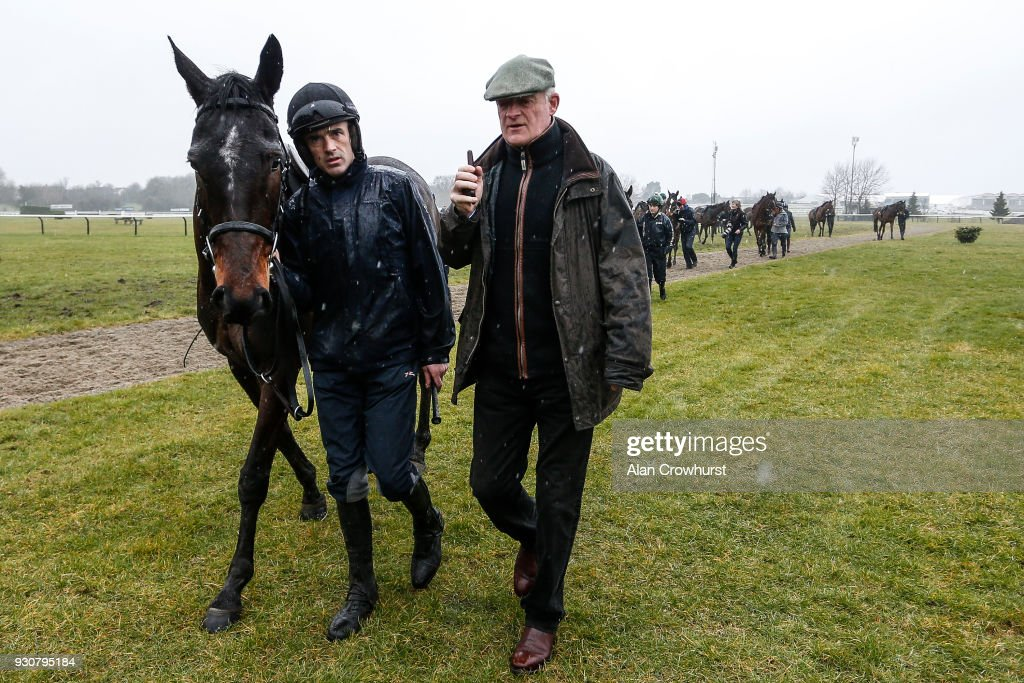 Ruby Walsh (L) chats with Willie Mullins as they leave the gallops at Cheltenham racecourse on March 12, 2018 in Cheltenham, England.