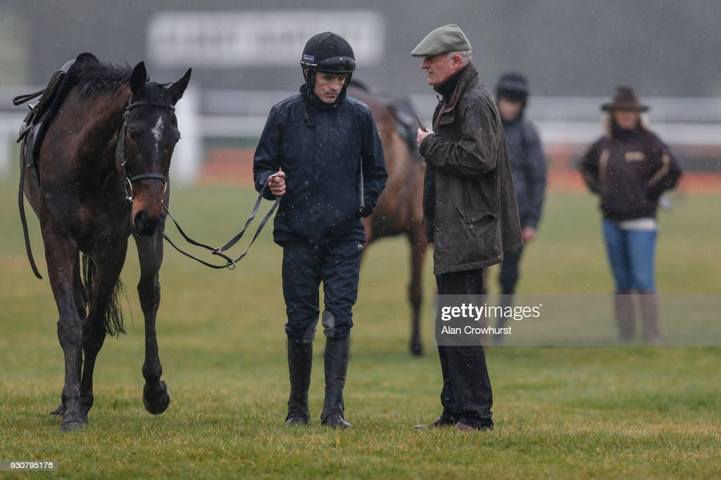 Ruby Walsh (L) chats with Willie Mullins on the gallops at Cheltenham racecourse on March 12, 2018 in Cheltenham, England.