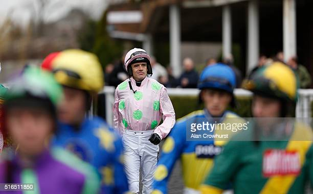 Ruby Walsh makes his way to the parade ring at Kempton Park racecourse on March 19 2016 in Sunbury England