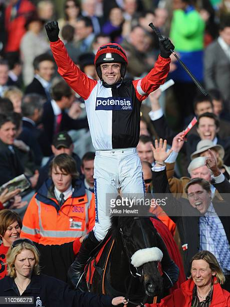 Ruby Walsh on Big Bucks celebrates victory in the Ladbrokes World Hurdle at Cheltenham Racecourse on St Patrick's Day on March 17 2011 in Cheltenham...