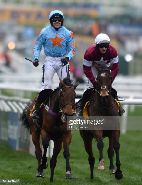 Ruby Walsh on board Un De Sceaux celebrates after victory in the Ryanair Steeple Chase during St Patrick's Thursday of the Cheltenham Festival at...
