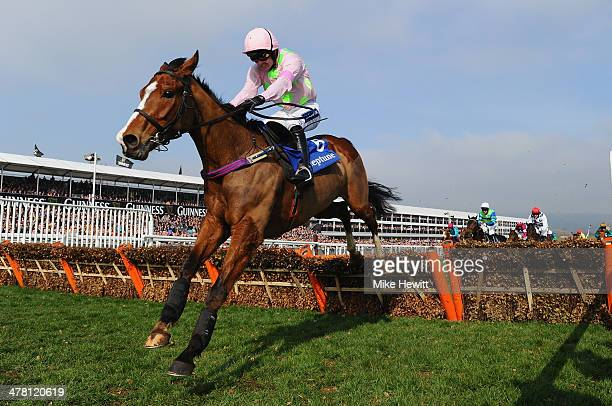 Ruby Walsh on Faugheen clears the last on their way to victory in the Neptune Investment Management Novices' Hurdle during Ladies Day at Cheltenham...