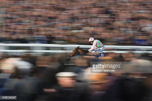 Ruby Walsh on Faugheen heads up to the finish line to win The Neptune Investment Management Novices' Hurdle during Ladies Day at the Cheltenham...