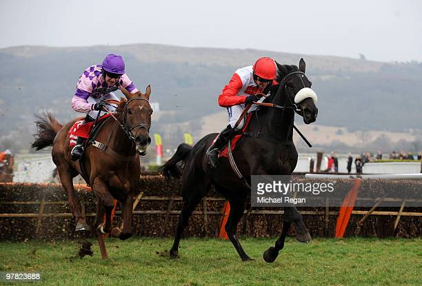Ruby Walsh rides Big Buck's to victory ahead of William Kennedy on Time for Rupert in The Ladbrokes World Hurdle Race during Ladies Day of the...