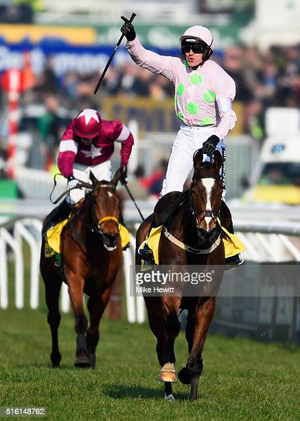 Ruby Walsh rides Vautour to victory in the Ryanair Chase on day three St Patrick's Thursday of the Cheltenham Festival at Cheltenham Racecourse on...