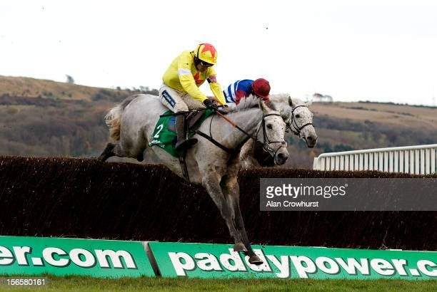 Ruby Walsh riding Al Ferof clears the last to win The Paddy Power Gold Cup Steeple Chase from Walkon at Cheltenham racecourse on November 17 2012 in...