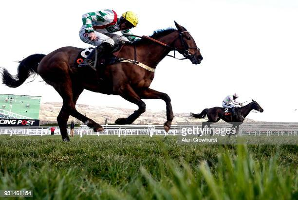 Ruby Walsh riding Benie Des Dieux win The OLBG Mares' Hurdle Race from Midnight Tour at Cheltenham racecourse on Champion Day on March 13 2018 in...