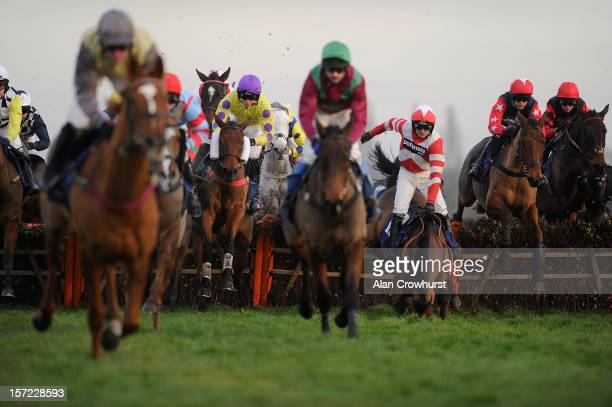 Ruby Walsh riding Curtain Razer fall in The Pertemps Handicap Hurdle Race at Newbury racecourse on November 30, 2012 in Newbury, England.