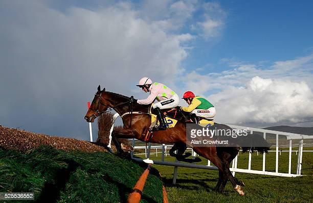 Ruby Walsh riding Douvan clear the first fence before winning The Ryanair Novice Steeplechase at Punchestown racecourse on April 28 2016 in Naas...