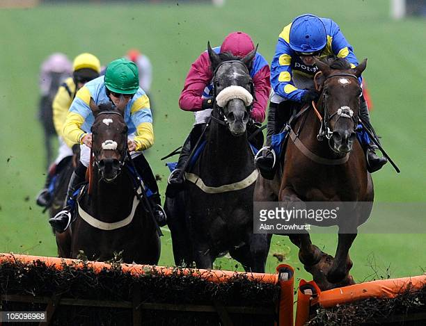 Ruby Walsh riding Escort'men jump the last to win The 40% Better Off On Betfair SP Hurdle Race at Chepstow racecourse on October 09, 2010 in...