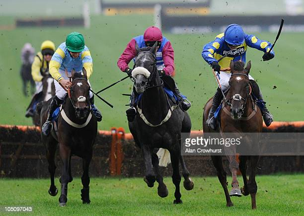 Ruby Walsh riding Escort'men jump the last to win The 40% Better Off On Betfair SP Hurdle Race from Olofi at Chepstow racecourse on October 09, 2010...