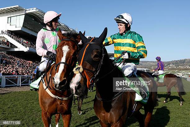 Ruby Walsh riding Faugheen are congratulated by Tony McCoy after winning The Stan James Champion Hurdle at Cheltenham racecourse on March 10 2015 in...