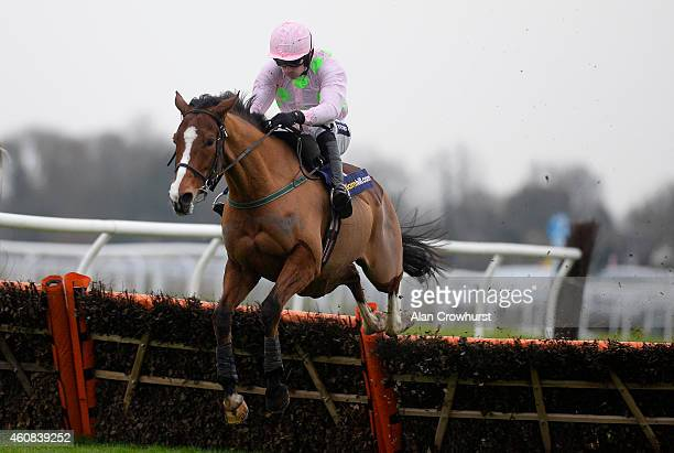 Ruby Walsh riding Faugheen clear the last to win The williamhillcom Christmas Hurdle Race at Kempton Park racecourse on December 26 2014 in Sunbury...