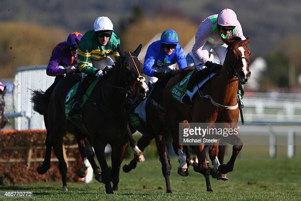 Ruby Walsh riding Faugheen on his way to victory alongside Tony McCoy riding Jezki in the Stan James Champion Hurdle Challenge Trophy on day one at...