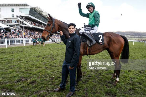 Ruby Walsh riding Footpad celebrate winning The Racing Post Arkle Challenge Trophy Novices' Chase at Cheltenham racecourse on Champion Day on March...
