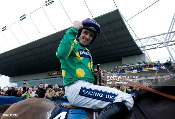 Ruby Walsh riding Kauto Star celebrates winning The William Hill King George VI Steeple Chase at Kempton racecourse on December 26, 2011 in Sunbury,...