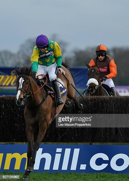 Ruby Walsh riding Kauto Star clears the last fence ahead of Long Run and Sam Waley-Cohen to win a historic William Hill King George VI Chase during...
